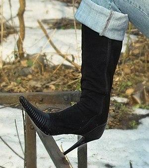 Black high-heeled boot. Image for 'Spike heel'...