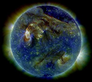 The Sun shows a C3-class solar flare (white ar...