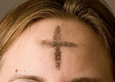 A cross of ashes on a worshipper's forehead on Ash Wednesday
