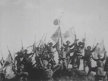 Imperial Japanese Army soldiers give a banzai ...