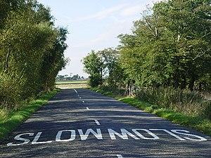 English: Slow Road.