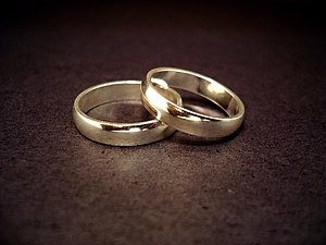 A couple of 14-carat gold wedding rings. Pictu...