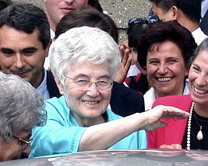 Chiara Lubich, smiling, surrounded by other sm...