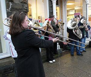 English: Brass band playing Christmas carols S...