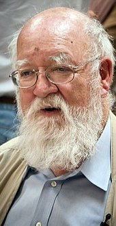 Dennett wearing a button-up shirt and a jacket