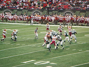 English: Brett Favre (#4) as quarterback for t...