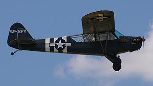A Piper L-4H Grasshopper (SP-AFY) in flight; G...