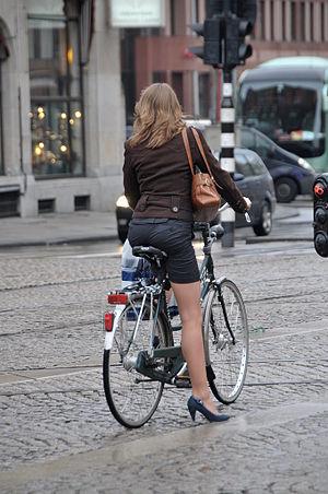 English: Beautiful girl on bike