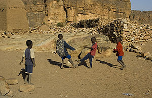 Children playing soccer, Dogon region, Mali