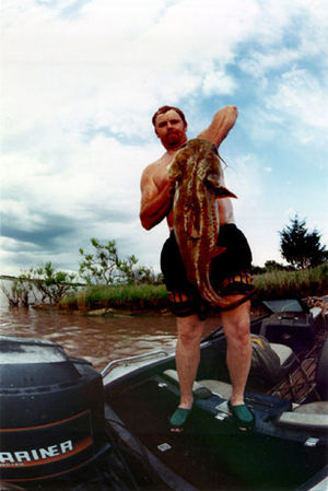 Lee McFarlin with a fish caught by noodling