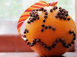 Orange pomander studded with cloves