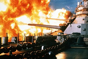 The USS New Jersey fires a salvo from her 16&q...