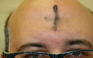 English: The forehead of a man with a cross dr...