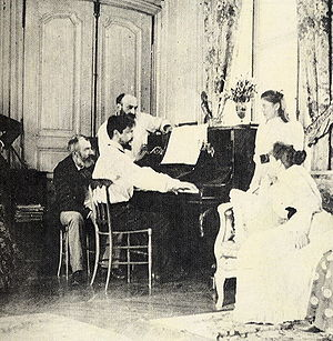 Debussy at the piano, in front of the composer...