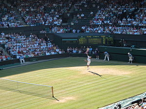 Roger Federer serving on Centre Court at the 2...