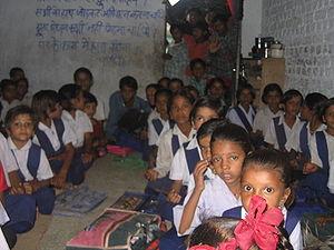 Children wearing uniforms at a primary school ...