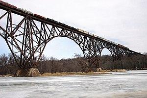 Train crossing the Arcola High Bridge on the S...