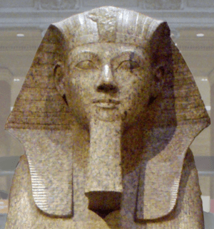 Closeup shot of a large granite sphinx bearing...