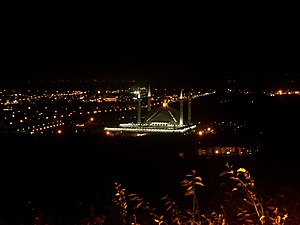 A night view of King Faisal Mosque and the sur...