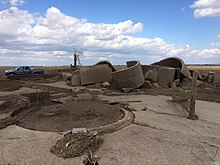 Image of a concrete reinforced silo that was completely demolished by the tornado