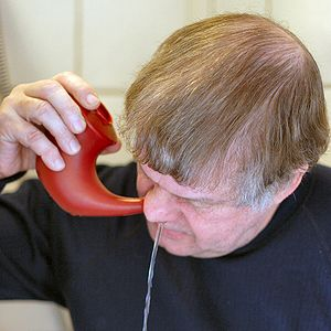 A man doing nasal irrigation