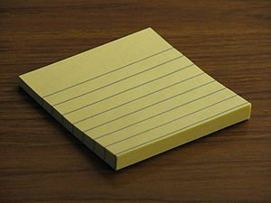 English: A small pad of Post-It notes.