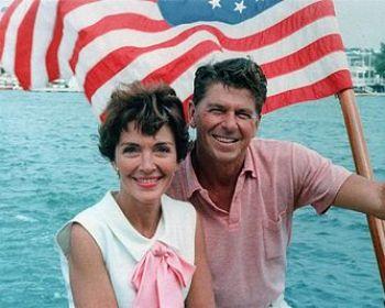 Ronald Reagan and Nancy Reagan aboard an Ameri...