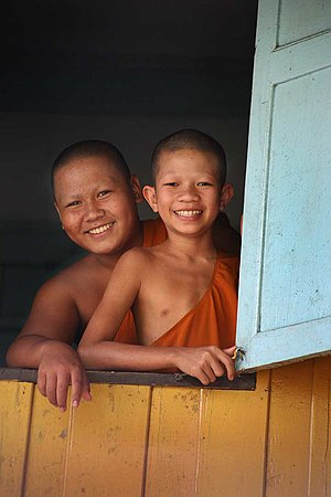 English: *description:Young Thai Buddhist monk...