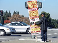 Paying people to hold signs is one of the olde...