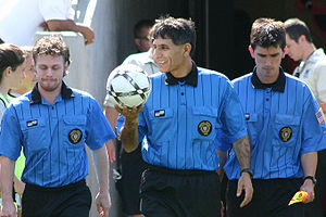 A soccer referee crew.