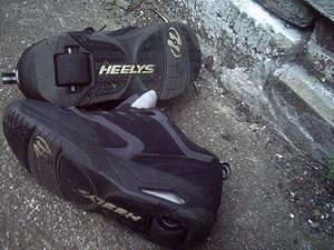 A pair of used Heelys.