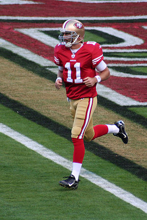 Alex Smith running onto the field before a 200...