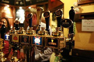 Beer taps in a pub in London, UK.