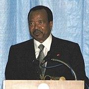 Biya behind podium.jpg