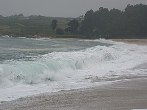 A wave breaks onto Carmel River State Beach