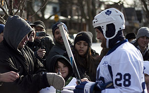 English: Number 28 Colton Orr signs autographs...