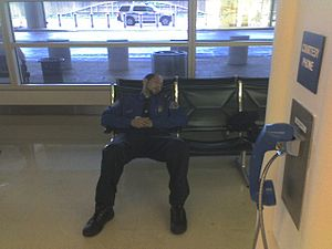 TSA employee sleeping at Reagan National Airpo...