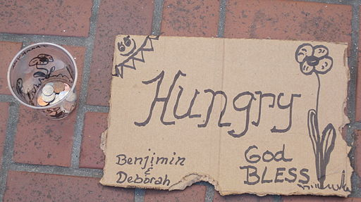 Hungry cardboard sign by Benjimin & Deborah SF