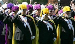 Members of the Knights of Columbus salute duri...