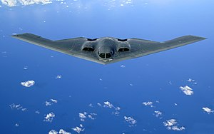 A B-2 Spirit soars after a refueling mission o...
