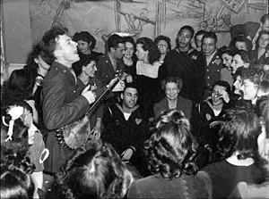 Pete Seeger im Weißen Haus 1941. In der Mitte des Bildes ist Eleanor Roosevelt.