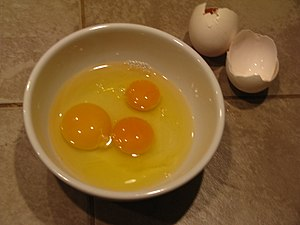 English: Three yolks from two chicken eggs; on...