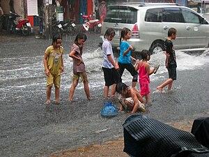 English: Children walking through the streets ...