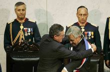 Piñera receives the presidential sash from Senate President Jorge Pizarro at the National Congress of Chile on 11 March 2010.