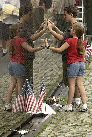 Visitors to the Vietnam Veterans Memorial Wall...