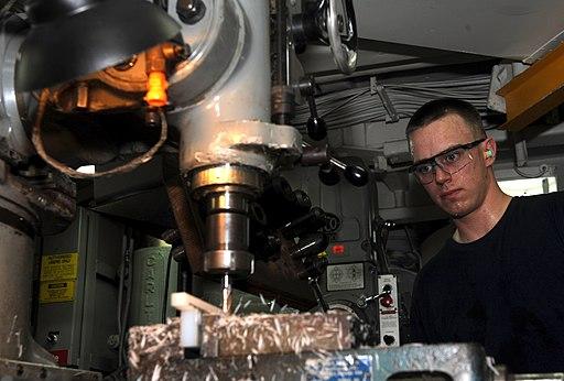US Navy 111025-N-OY799-174 Machinery Repairman Fireman Dane McDonald, from Milwaukee, Wis., fabricates a tool on a universal milling machine