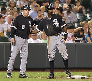 English: White Sox 3rd base coach with player .