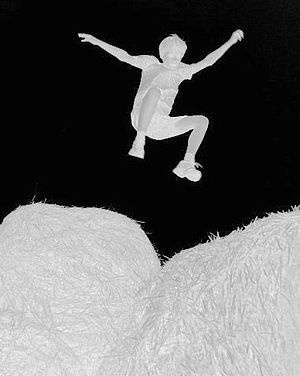 English: Negative image of the boy Guy jumping...
