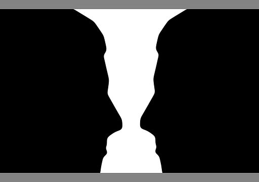 Two silhouette profile or a white vase