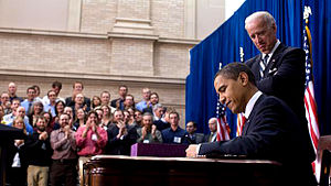 United States President Barack Obama signs int...